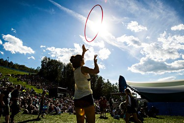 Katie MacMillan hula hoops to Danny Michel's set at Stage 5 during the Edmonton Folk Music Festival at Gallagher Park in Edmonton, Alta. on Saturday, Aug. 8, 2015. Codie McLachlan/Edmonton Sun/Postmedia Network