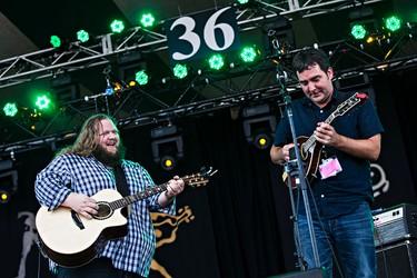 Matt Andersen, left, performs on the main stage during the Edmonton Folk Music Festival at Gallagher Park in Edmonton, Alta. on Saturday, Aug. 8, 2015. Codie McLachlan/Edmonton Sun/Postmedia Network