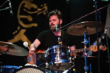 Kev Jones of Bear's Den performs on the main stage during the Edmonton Folk Music Festival at Gallagher Park in Edmonton, Alta. on Saturday, Aug. 8, 2015. Codie McLachlan/Edmonton Sun/Postmedia Network