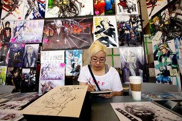 Artist Susan Leigh works on a drawing during the final day of Animethon at MacEwan University, in Edmonton Alta. on Sunday Aug. 9, 2015. David Bloom/Edmonton Sun/Postmedia Network