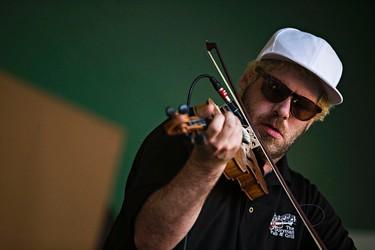 Ashley MacIsaac performs at Stage 5 during the Edmonton Folk Music Festival at Gallagher Park in Edmonton, Alta. on Friday, Aug. 7, 2015. Codie McLachlan/Edmonton Sun/Postmedia Network