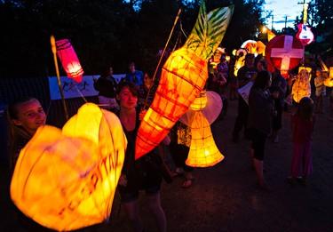 The lantern parade prepares to move during the Edmonton Folk Music Festival at Gallagher Park in Edmonton, Alta. on Saturday, Aug. 8, 2015. Codie McLachlan/Edmonton Sun/Postmedia Network