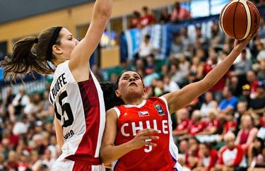 Canada's Michelle Plouffe blocks Chile's Dafne Bermudez during Canada's 2015 FIBA Americas Women's Championship basketball game against Chile at the Saville Community Sports Centre in Edmonton, Alta. on Monday, Aug. 10, 2015. Canada won 93-36. Codie McLachlan/Edmonton Sun/Postmedia Network