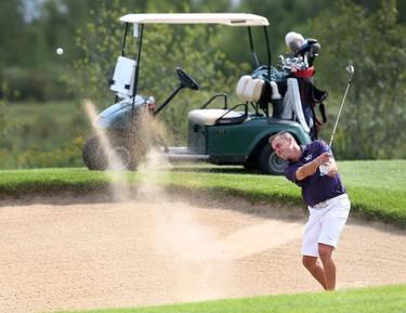 Allen McGee hits a bunker shot during the Ottawa Sun Scramble City Championship at Grey Hawk Golf Club in Ottawa Ontario Friday Aug 28, 2015. Friday's golfers took part in the Senior Open.  Tony Caldwell/Ottawa Sun/Postmedia Network