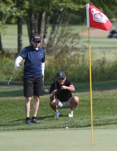 Kerry Boire watches his partner Ron Flanagan putt during the Ottawa Sun Scramble City Championship at Grey Hawk Golf Club in Ottawa Ontario Friday Aug 28, 2015. Friday's golfers took part in the Senior Open.  Tony Caldwell/Ottawa Sun/Postmedia Network
