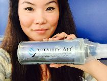 Hannah Lam holds a can of Vitality Air.