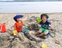 Eden Abols, 5, left, and William Heyerichs-Berton, 4, play on the main beach at Bell Park in Sudbury, Ont. on Aug. 31, 2015. John Lappa/Postmedia Network