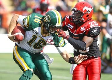Edmonton Eskimos, Matt Nichols gets caught by Calgary StampedersKeon Raymond during the first half of CFL action at McMahon stadium in Calgary on Labour Day. Monday September 3  2012.DARREN MAKOWICHUK/CALGARY SUN QMI AGENCY