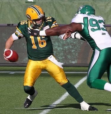 Eskimos quarterback  Matt Nichols is sacked by Tearrius George during first half CFL pre-season action at Commonwealth Stadium in Edmonton, Alberta on Friday, June 14, 2013. PERRY NELSON/EDMONTON SUN/QMI AGENCY