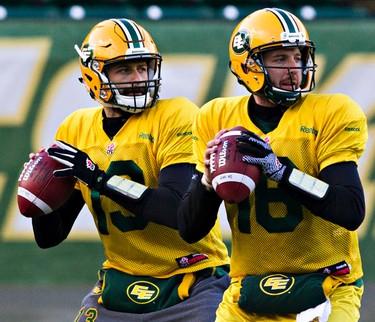 Mirror me. Quarterbacks Mike Reilly, left, and Matt Nichols, right, throw the ball during Edmonton Eskimos practice at Commonwealth Stadium in Edmonton, Alta., on Friday, Nov. 21, 2014. Codie McLachlan/Edmonton Sun/QMI Agency