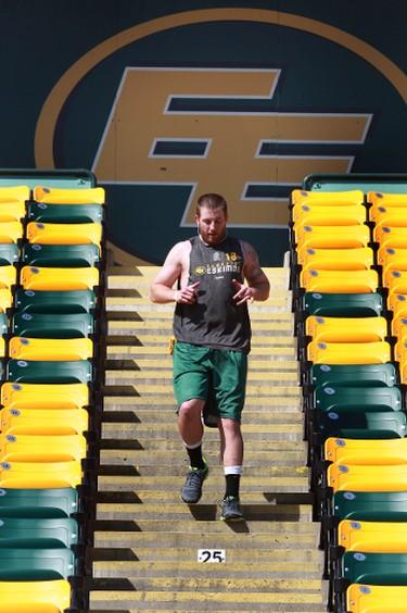 Edmonton Eskimos' Matt Nichols runs the steps at Commonwealth Stadium in Edmonton, Alberta on April 23,  2013.  Perry Mah/Edmonton Sun/QMI Agency