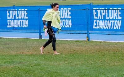 A cold triathlete runs to dry off after swim training for the 2015 ITU World Triathlon Edmonton in Hawrelak Park, in Edmonton Alta. on Friday Sept. 4, 2015. David Bloom/Edmonton Sun/Postmedia Network
