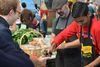 Garlic barristas pass free shots of fresh pressed Ontario garlic at Toronto Garlic Festival in this undated handout photo. (HO - Toronto Garlic Festival)
