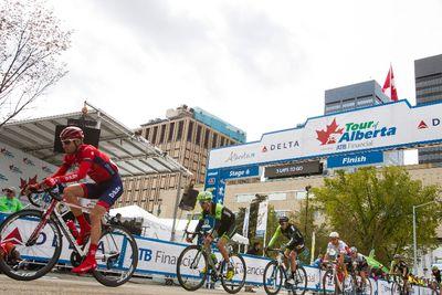 The peloton passes through the finish line during the Tour of Alberta final in Edmonton, Alta., on Monday September 7, 2015. Ian Kucerak/Edmonton Sun/Postmedia Network