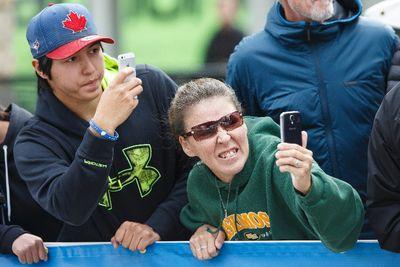Fans take photos during the Tour of Alberta final in Edmonton, Alta., on Monday September 7, 2015. Bauke Mollima with Trek Factory Racing won the race and Cannondale-Garmin took the team title. Ian Kucerak/Edmonton Sun/Postmedia Network