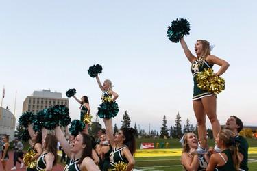 Golden Bears cheerleaders perform during a CIS football game between the University of Alberta Golden Bears and the University of Saskatchewan Huskies at Foote Field in Edmonton, Alta., on Friday September 11, 2015. Ian Kucerak/Edmonton Sun/Postmedia Network