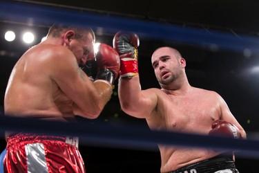 Paul MacKenzie (right) of Edmonton fights Emile Arsenault of Shediac, N.B., during a KO Boxing card at the Shaw Conference Centre in Edmonton, Alta., on Friday September 11, 2015. MacKenzie won the fight. Ian Kucerak/Edmonton Sun/Postmedia Network