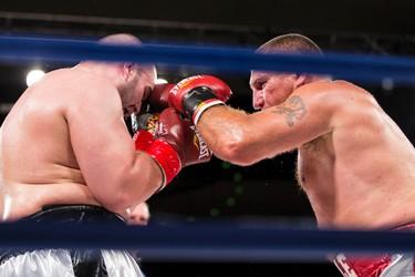 Paul MacKenzie (left) of Edmonton fights Emile Arsenault of Shediac, N.B., during a KO Boxing card at the Shaw Conference Centre in Edmonton, Alta., on Friday September 11, 2015. MacKenzie won the fight. Ian Kucerak/Edmonton Sun/Postmedia Network