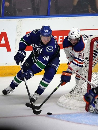 Edmonton Oilers'  Braden Christoffer checks Vancouver Canucks' Hunter Shinkaruk during 3rd period in Young Star game at  Penticton, BC on September11 2015. Perry Mah/Edmonton Sun/Postmedia Network