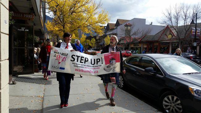 Banff mayor Karen Sorensen and Canmore mayor John Borrowman lead the Walk-a-Mile fundraiser through downtown Canmore on Wednesday, Sept. 16, 2015. Amanda Symynuk/Crag & Canyon