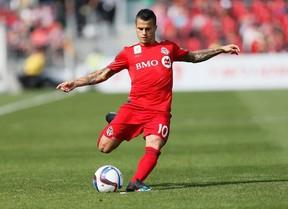 TFC's Sebastian Giovinco takes a free kick against Chicago on Saturday. (USA TODAY SPORTS)