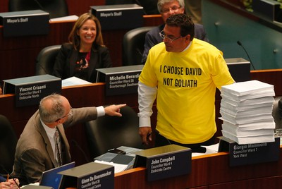 Councillor Giorgio Mammoliti presents 7,000 petitions at the taxi debate at Toronto City Hall Wednesday September 30, 2015. (Michael Peake/Toronto Sun)