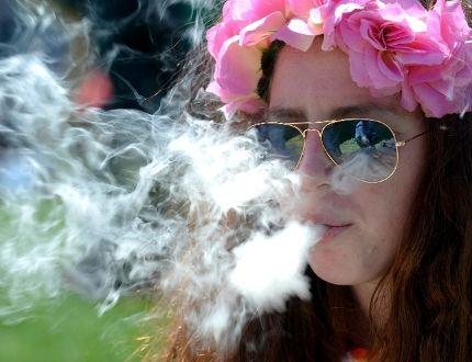 Woman smokes marijuana at a rally
