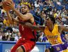 Raptors guard Cory Joseph drives past Lakers guard Louis Williams during the Thursday night's game. (AP Photo/Alex Gallardo)