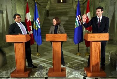 Premier Alison Redford (c) met with Calgary Mayor Naheed Nenshi (l) and Edmonton Mayor Elect Don Iveson at the Alberta Legislature in Edmonton. Alberta on Saturday, Oct 26, 2013.  PERRY MAH/Edmonton Sun/QMI Agency