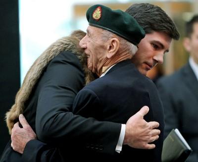 Lest We Forget. Edmonton Mayor Don Iveson hugs veteran Maurice White during Remembrance ceremonies at City Hall in Edmonton, Alta., on Tuesday Nov 11 , 2014. Perry Mah/Edmonton Sun/QMI Agency