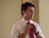 Liberal leader Justin Trudeau adjusts his tie