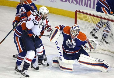 Edmonton Oilers' goaltender Anders Nilsson (39) stops  Washington Capital's  Washington Capitals forward Tom Wilson (43) during 1st period NHL action at Rexall Place in Edmonton, Alberta on October 21, 2015. Perry Mah/Edmonton Sun/Postmedia Network