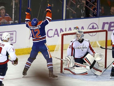 Edmonton Oilers' forward Rob Klinkhammer (12) scores on Washington Capital's  Washington Capitals goaltender Philipp Grubauer (31) during 1st period NHL action at Rexall Place in Edmonton, Alberta on October 21, 2015. Perry Mah/Edmonton Sun/Postmedia Network