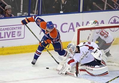 Edmonton Oilers' forward Connor McDavid (97) is topped byWashington Capital's  Washington Capitals goaltender Philipp Grubauer (31) during 1st period NHL action at Rexall Place in Edmonton, Alberta on October 21, 2015. Perry Mah/Edmonton Sun/Postmedia Network