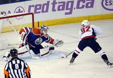 Edmonton Oilers' goaltender Anders Nilsson (39) is scored on by Washington Capital's  Washington Capitals forward Evgeny Kuznetsov (92) during 2nd period NHL action at Rexall Place in Edmonton, Alberta on October 21, 2015. Perry Mah/Edmonton Sun/Postmedia Network