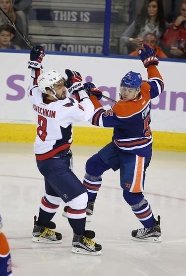 Edmonton Oilers' defensemen Mark Fayne (5) dances with Washington Capitals'  Washington Capitals forward Alex Ovechkin (8) during 3rd period NHL action at Rexall Place in Edmonton, Alberta on October 21, 2015. Perry Mah/Edmonton Sun/Postmedia Network