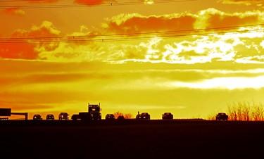 Golden Commuters. Vehicles travel east and west on long Manning Dr., as the sun sets on Oct 22, 2015 in Edmonton, Alta. Hugo Sanchez/Edmonton Sun