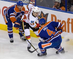 Brandon Davidson (88) keeps tabs on Calgary's Garnet Hathaway during an NHL  game at Rexall Place last month (David Bloom, Edmonton Sun).