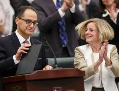 Finance Minister Joe Ceci (left) concludes his Budget 2015 speech next to Premier Rachel Notley (right) on the floor of the Alberta Legislature in Edmonton, Alta., on Tuesday October 27, 2015. Ian Kucerak/Edmonton Sun/