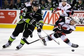 Edmonton's Lane Bauer (25) battles Moose Jaw's Jesse Shynkaruk (8) during a WHL game at Rexall Place last month (David Bloom, Edmonton Sun).
