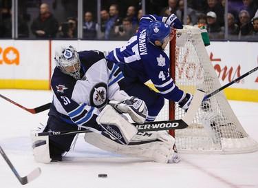 Nov 4, 2015; Toronto, Ontario, CAN; Winnipeg Jets goaltender Ondrej Pavelec (31) makes a save as Toronto Maple Leafs forward Leo Komarov (47) crashes the net during the first period at Air Canada Centre. Mandatory Credit: John E. Sokolowski-USA TODAY Sports