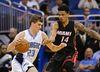 Orlando Magic forward Mario Hezonja (23) drives around Miami Heat guard Gerald Green (14) during the first half of an NBA preseason basketball game, Tuesday, Oct. 13, 2015, in Orlando, Fla. (AP Photo/John Raoux)