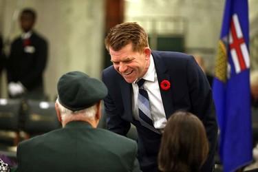 Wildrose Leader Brian Jean chats with veterans at Remembrance Day ceremony at the Alberta Legislature in Edmonton, Alberta on November 5, 2015.  Perry Mah/Edmonton Sun/Postmedia Network