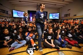 Jordan Eberle walks through a gym full of kids as Harrison and Chloe Katz launch their Hockey Helps Kids Foundation at Riverbend School on October 6, 2015 in Edmonton, Alta. Perry Mah/Edmonton Sun/Postmedia