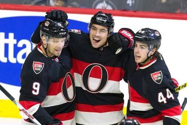 Ottawa Senators' Cody Ceci (5) celebrates his goal wth teammates Jean-Gabriel Pageau (44) and Milan Michalek (9) during first period NHL hockey against the Winnipeg Jets in Ottawa on Thursday, November 5, 2015. THE CANADIAN PRESS/Fred Chartrand