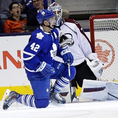 Toronto Maple Leafs  Tyler Bozak (42) celebrates his goal with Colorado Avalanche goalie Reto Berra (20) looking on in Toronto on Tuesday November 17, 2015. Craig Robertson/Toronto Sun/Postmedia Network