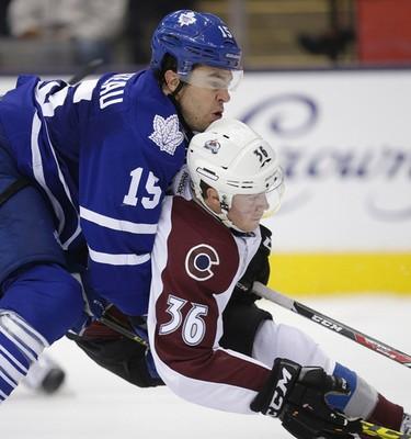 Toronto Maple Leafs right wing P.A. Parenteau (15) takes down Colorado Avalanche Chris Wagner in Toronto on Tuesday November 17, 2015. Craig Robertson/Toronto Sun/Postmedia Network