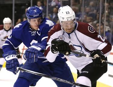 Toronto Maple Leafs  Dion Phaneuf (3)  battles Colorado Avalanche center Mikhail Grigorenko (25) in Toronto on Tuesday November 17, 2015. Craig Robertson/Toronto Sun/Postmedia Network