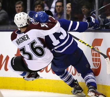 Toronto Maple Leafs right wing P.A. Parenteau (15) battles  Colorado Avalanche Chris Wagner in Toronto on Tuesday November 17, 2015. Craig Robertson/Toronto Sun/Postmedia Network