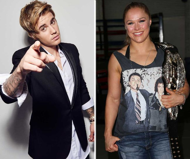 Justin Bieber and Ronda Rousey. (Handout/WENN)